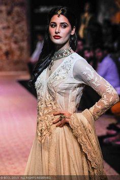 Nargis Fakhri showcases a creation by designer Ritu Kumar on Day 5 of the Lakme Fashion Week (LFW) Winter/Festive 2013, held at Grand Hyatt, Mumbai, on August 26, 2013.