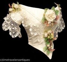 This is absolutely wonderful use of lace, ribbon, and florials