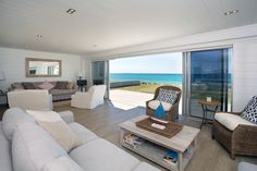 The living room with sliding stacker doors. Great views out to sea. All white Lockwood interior.