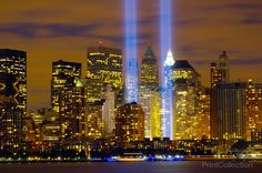 "The ""Tribute in Light"" memorial is in remembrance of the events of Sept. 11, 2001. The two towers of light are composed of two banks of high wattage spotlights that point straight up from a lot next t"