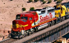 ATSF #151 (EMD GP60M) rockets through Abo Canyon, NM in 1994. Roster photo by Sammy Carlile.