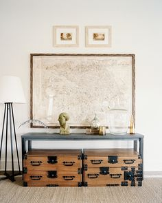 love the travel theme with vintage suitcases for textured look and a world map