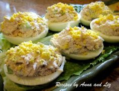 Tuna-Stuffed Eggs recipe. Not a traditional deviled eggs recipe - hard boiled eggs stuffed with light tuna salad, a hint of lemon, and garnished with crumbled yolks on top. Delicious appetizer or brunch item.
