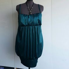 PLUS 2X DRESS. TORRID Beautiful teal necklace slinky dress .polyester . Bust from seam to seam is 28 inches. Padded no bra needed. . torrid Dresses Prom