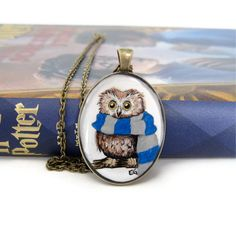 Support your favorite Hogwarts house with this adorable little Harry Potter inspired art pendant!