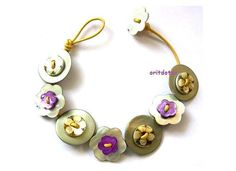 Bracelet button jewelry made of shell flowers buttons on white leather cord