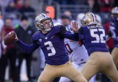Quarterback Jake Browning #3 of the Washington Huskies passes the ball during the first half of a football game at Husky Stadium on November 27, 2015 in Seattle, Washington. Photo: Stephen Brashear, Getty Images / 2015 Getty Images