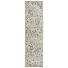 This swirling transitional rug offers immense beauty and style in a nontraditional way. The pattern features leaves and vines in silver. The materials are all synthetic. The rug is designed for indoor use. Measurements are 23 x 8.