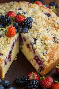 Must-try Berry Crumb Cake Recipe with a buttery crunchy topping, juicy layer of strawberries, blueberries and blackberries and a soft, airy cake. This crumb cake rises beautifully and looks stunning. No one has to know it was SUPER EASY. One of our top easy cake recipes! | natashaskitchen.com