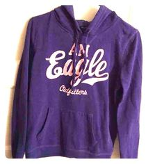 American Eagle Hoodie Purple with pink lettering, size M. Lightweight, gently used hoodie that's been sitting in my drawer. No longer fits me.  Disclaimer: I have two cats but that doesn't affect quality. A few stray strands of fuzz may be on it but I will do my best to use a lint roller before I ship out anything.  Purple pink American Eagle Hoodie Medium American Eagle Outfitters Tops Sweatshirts & Hoodies