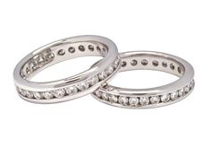These two diamond wedding rings are the same style. Each has round brilliant cut diamonds flowing around the ring in delicately crafted channel settings. The bands are made of shining white gold.     Tungsten Carbide Wedding Bands for Men and Women