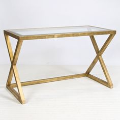 Worlds Away - Mark Gold Leafed Desk/Console Gold leaf X side iron desk/console w/ beveled glass top.