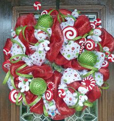 Cute little snowmen everywhere! This wreath is made with deluxe deco mesh and is adorned with all things Christmas.snowmen, red, white and lime green polka dot ribbon, red and white candy, glitter garland and ornaments! Deco Wreaths, Xmas Wreaths, Christmas Decorations, Christmas Ornaments, All Things Christmas, Holiday Fun, Christmas Holidays, Holiday Ideas, Christmas Yard