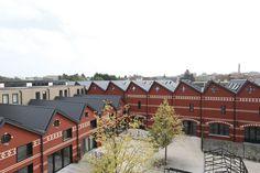 Îlot Desclée (Tournai) - Rénovation et extension d'une ancienne imprimerie du début du XXème siècle en lofts basse énergie. Photo:Laurent Brandajs, A.A.M.W.