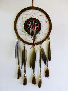 Brown  Dream Catcher with leather by THEWORLDOFFEATHERS on Etsy, $20.00