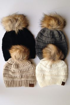 Pom knit CC Beanie available in four colors: beige, ivory, gray, and black.