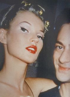 Holy cat eye. Kate Moss and John Gallianobackstage atGalliano's Autumn 1994 Sao Schlumberger Collection  (Scanned from Vogue UK Feburary 2007)