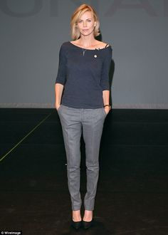 Professional chic: Charlize Theron meant business as she attended an AIDS conference at th...