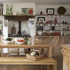 Bench seats and an #Aga. The shelves & buffet are built in. Great use of space. Oh & I rather like that kettle.