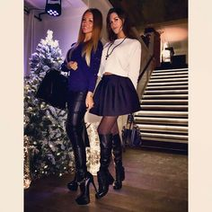 Amateur girls in boots by Christmas tree