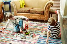 buy those cheap rag rugs from Wal-Mart and sew them together to make a large area rug!