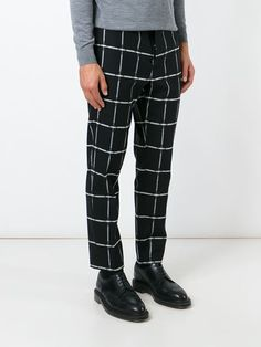 Black and white wool-cotton blend checked trousers from MSGM