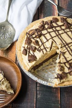 Chocolate Bottomed Peanut Butter Pie - Pillsbury Refrigerator Pie Crust - chocolate chips - heavy cream - corn syrup or honey - vanilla extract - small box instant vanilla pudding mix - milk - creamy peanut butter - Cool Whip - Reese's mini cups - chocolate for drizzling