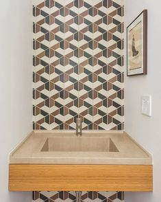 As @tilemakestheroom points out: kudos to whoever patiently cut the teeny tiny edge triangles! Design: Braude Pankiewicz Architects. : Cameron Blaylock