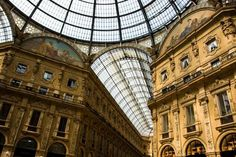 """Galleria Vittorio Emanuele II, Milan    The glass-covered shopping arcade at the center of Milan, tucked between the Duomo and La Scala and inaugurated in 1867, is the prototype for shopping malls around the world. Milanese are proud to refer to their landmark as the """"Salotto di Milano"""" (Living Room of Milan).    Photo by Lucabertol/Dreamstime.com"""