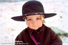 portrait of a young amish boy