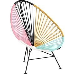Acapulco Lounge Chair: These chairs do double duty—you can take them out on the deck, like their home at the Surfcomber, but we love them against a plain white wall as a conversation piece for the room.