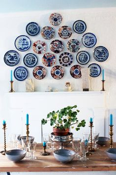 Marshall first began collecting Canton plates for dinner service, but his trove grew so large that he decided to hang them as art alongside some Imari porcelain pieces in the dining area | archdigest.com