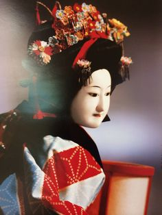 Japanese bunraku puppet. The costumes are designed by a costume master and are composed of a series of garments with varying colors and patterns. These garments typically include a sash and a collar as well as an under robe (juban), an inner kimono (kitsuke), a vest (haori) or an outer robe (uchikake). In order to keep the costumes soft they are lined with cotton. The process of dressing or redressing the puppets by the puppeteers is called koshirae.