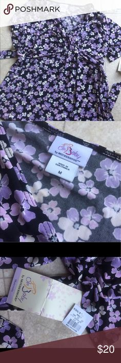 Baby doll Maternity Top Baby doll Maternity short sleeved Top. Black with purple/pink flowers ties in the back. Stretchy and soft material. NWT Oh Baby by Motherhood Tops Blouses