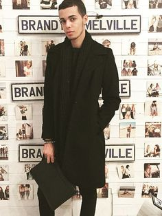 dinhuwilliams at SOHO New York wearing a all black style trench coat (Men's Style)