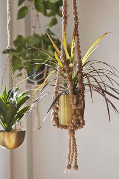 Sienna Beaded Plant Hanger from Urban Outfitters. Shop more products from Urban Outfitters on Wanelo.