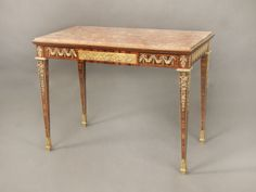 A Very Fine Late 19th Century Louis XVI Style Gilt Bronze Mounted Occassional Table