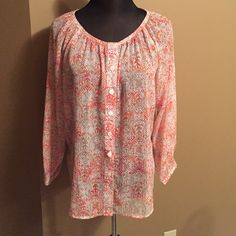 Tribal Print Button Down Blouse EEUC and worn a couple times. This blouse is coral and tan with a tribal print and white buttons going down the front. Would look super cute with white or khaki pants. Tag says 12 but would fit a large. Lark Lane Tops Button Down Shirts