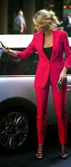 Black Lively is gorgeous in this fuschia suit