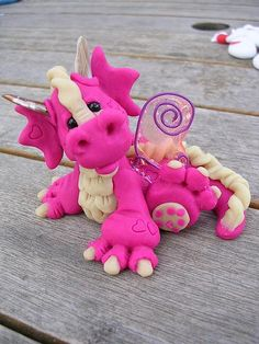 Pink polymer clay dragon. So cute.