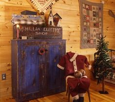 Blue Christmas: Paired with a dark but similarly distressed wood box and a quilt that boasts lighter blue hues, a vibrantly painted hutch manages to blend in well in Helen and Tom Roe\