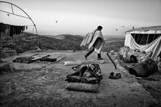 Cédric Gerbehaye. PALESTINE. A Palestinian man wakes up in the ruins of his family's West Bank house, destroyed by the Israeli army, in the village of Mufakara in the hills south of Hebron, June 7, 2013
