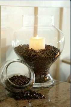 I love this idea! Saw a version of this done at a Starbuck's once and they used the jar fulla coffee beans to hold pens at the checkout! haha!;)♥