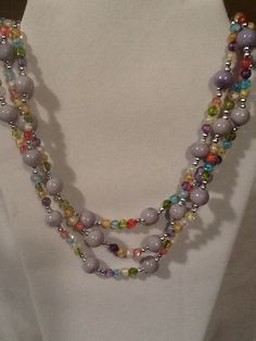 Hey, I found this really awesome Etsy listing at https://www.etsy.com/listing/191488204/multi-strand-pale-purple-and-multicolor