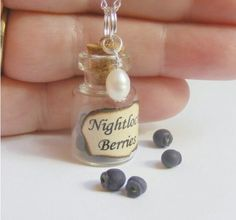 The hunger games inspired nightlock berries pearl bottle necklace