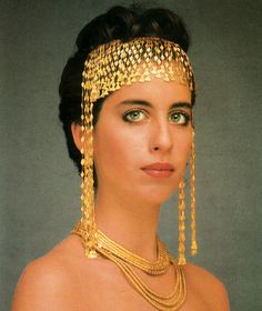 """Maria Lalaounis wearing a gold diadem and necklace created by her father, the famous greek jewellery maker , Ilias Lalounis for his collection """"Helen of Troy"""". This collection was inspired by the treasure of Troy that was found by archaeologist Heinrich Schliemann in 1873"""
