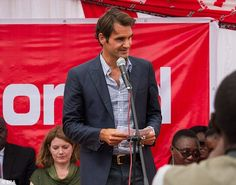 Roger Federer, pictured at a charity event in Malawi last week, has pulled out of the Rogers Cup in Montreal