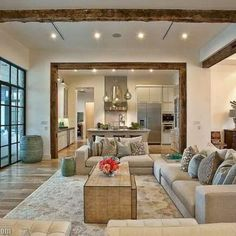 The Statement Piece | ProSource Wholesale  Rustic wood beams ground this modern living space in timeless character.