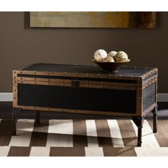 Make a statement with this travel trunk cocktail table. Opening the intricately designed latch reveals ample trunk space, perfect for storing living room accessories like blankets, board games or laptops. Black Coffee Tables, Lift Top Coffee Table, Coffee Table With Storage, Blanket Storage, Cocktail Tables, Diy, Decoration, Storage Spaces, Cocktails