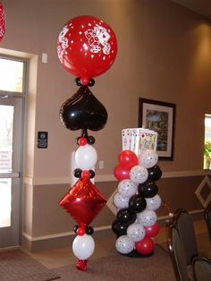 Balloons for a high impact low cost entrance. I would like 1 of each on both sides of the doorway, with a casino sign above.